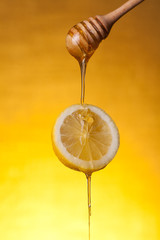 Honey flowing on lemon slice