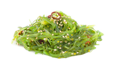 Chuka salad sprinkled with sesame seeds on a white background