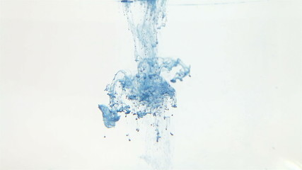 Blue ink in water on a white background