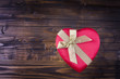 Heart on a wooden background.