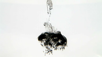 Black watercolor dropped into water isolated on white