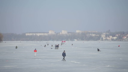 People walking on a frozen lake ii