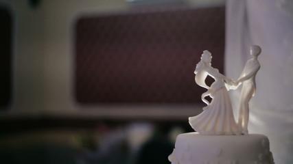 Wedding cake and groom figurines