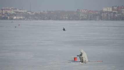 Winter fishing on a frozen lake