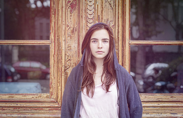 toned image, portrait of a teenager girl in front of a old woode