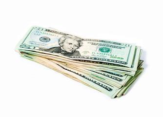 Stack of money american twenty dollar bills over white.