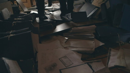 Documents are scattered on the floor after robbery