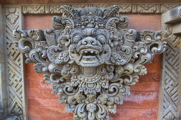 Stone sculpture decorating a temple wall, Bali island