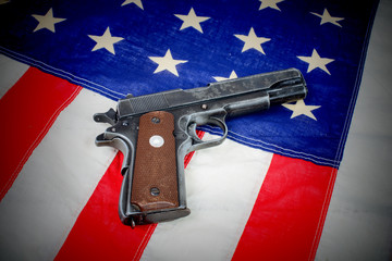 gun laid on the American flag