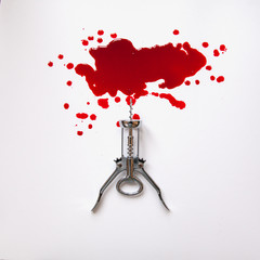 Corkscrew in a blood pool on a white background