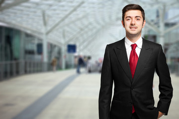 Smiling businessman standing outdoor