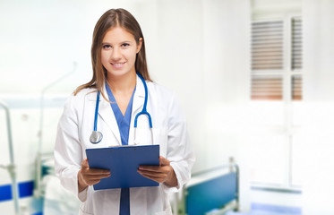 Smiling female doctor in a hospital room