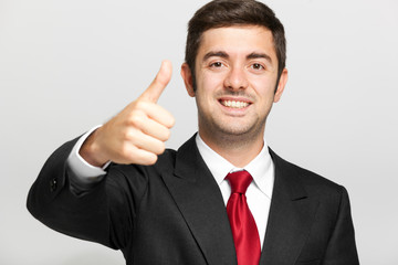 Young man thumbs up