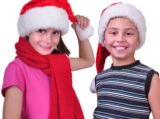 boy and girl with Christmas Santa Claus red hats