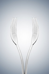 Artistic cup of wine form or hands form made with two forks.