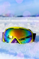 View of ski mask on white snow with snowflakes