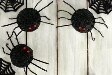 Halloween spider cupcake corner border on white wood
