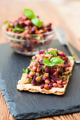 bruschetta with green lentils, avocado, beets and peanuts