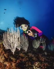 Italy, Tyrrhenian Sea, diver and white gorgonians