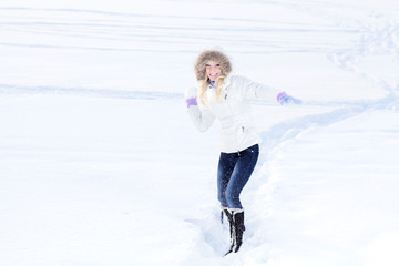 Young woman playing with snowball