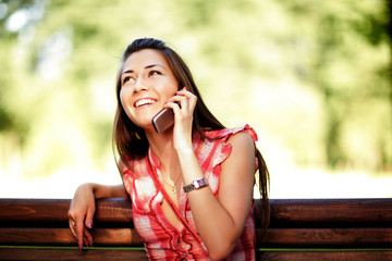 Young caucasian woman talking on cell phone.