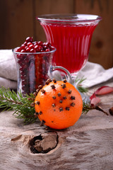 ingredients for a spicy autumn winter drink with cranberries and