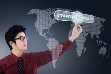 Asian businessman and start button