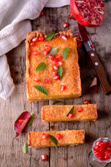 orange tart with pomegranate fresh mint leaves