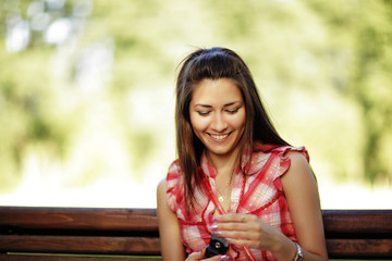 Young caucasian woman texting on cell phone.
