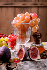 Still life with autumn fruit honey and nuts on an old wooden