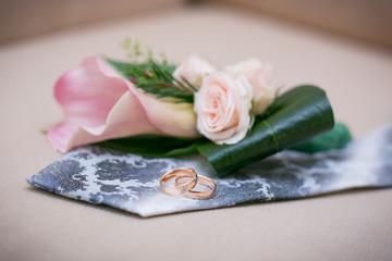 Wedding rings on the groom's tie