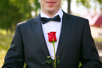 Groom with rose