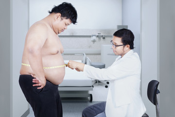 Doctor examining a patient obesity