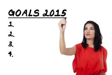 Hispanic woman writes her goals