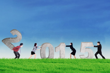 Teamwork collaborate to compose number 2015