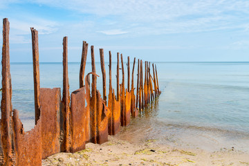 rusty breakwater with the sea in the background