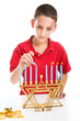 Jewish Boy Lights Menorah