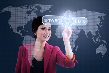 Woman pressing business start button