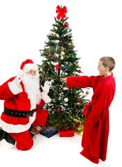 Boy Surprises Santa Claus