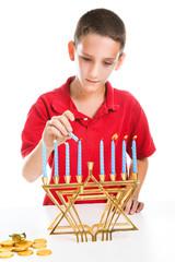 Jewish Boy Lights Menorah