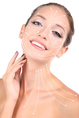 Face massage. Beautiful girl with glowing skin close-up