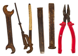 Old isolated tools:chisel, pliers, wrench, adjustable spanner