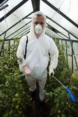 Gardener in protective clothing