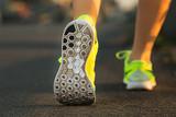 Fototapety Runner woman feet running on road closeup on shoe.
