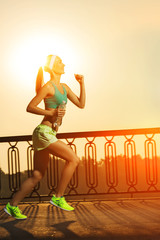 Running woman. Runner is jogging on sunrise outdoors