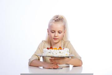 Girl looking at cake