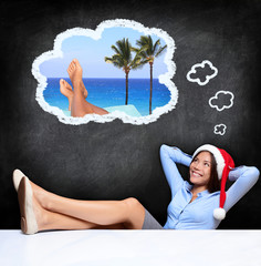 Young woman dreaming about holidays
