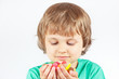 Child with sweets and jelly candies on a white background