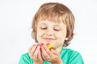 Smiling child with sweets and jelly candies