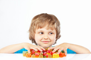 Boy with sweets and candies on a white background